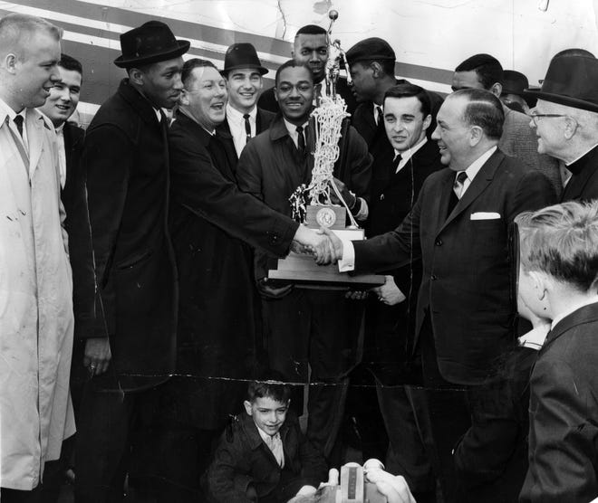 Members of Loyola's national title team are greeted by Chicago Mayor Richard J. Daley on March 24, 1963.