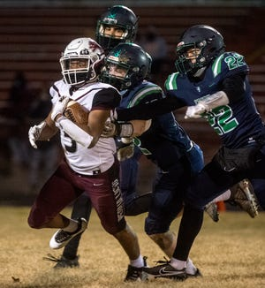A trio of Notre Dame defenders pursue Peoria High running back Eddie Clark this spring. The Peoria rivals meet this season in Week 9.