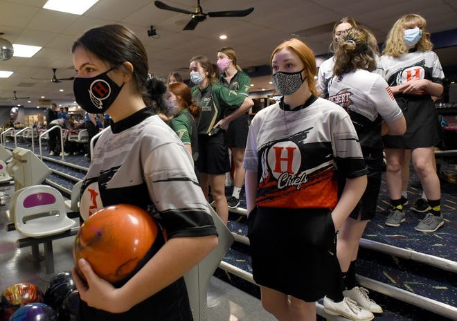 Julia Skowron of New Boston Huron starts to warm up, followed by Marissa Martin as they bowled against SMCC at Monroe Sports Center earlier this season. Behind for SMCC are Colleen Castiglione, Kylie Barron and Grace Lipford.