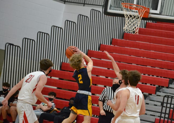Airport's Adam Goins goes to the basket against Milan Friday night.