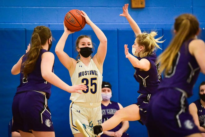 Mt. Markham's Hayleigh Gates (35) attempts to pass the ball to a teammate during a game against West Canada Valley on Friday, March 19, 2021. Gates scored 24 points in Mt. Markham's 59-44 win.