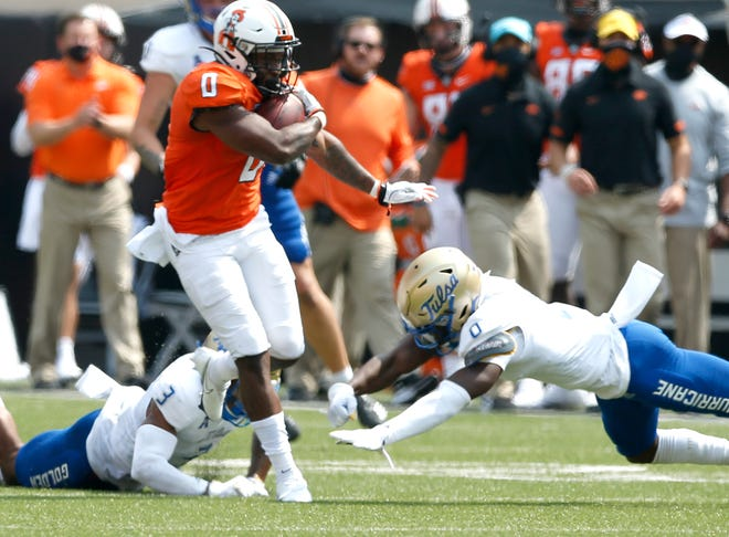 Oklahoma State's LD Brown could be in line to become the Cowboys' featured running back, but the Pokes have options in spring. [JOHN CLANTON/TULSA WORLD]