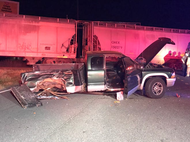 The driver of this pickup truck drove around a railroad crossing gate late Friday at County Road 25 and Baseline Road in Belleview. A northbound CSX train hit the vehicle, but neither the man nor his female passenger was injured.