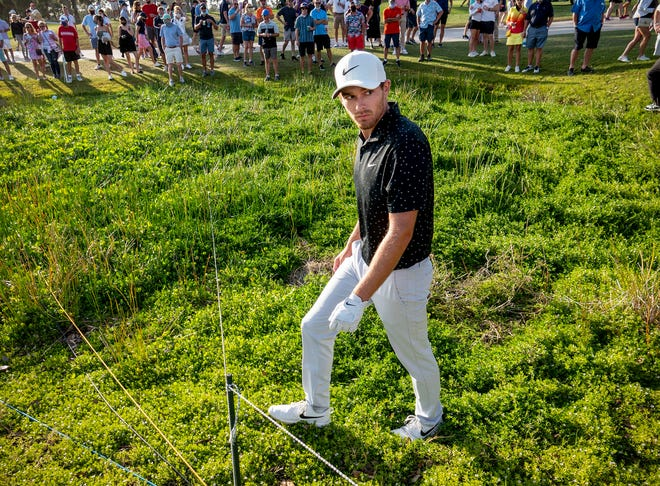 Aaron Wise loses his tee shot in the rough on the 18th hole during Saturday's third round. He ended up bogeying the hole and carding a 39 on the back nine.