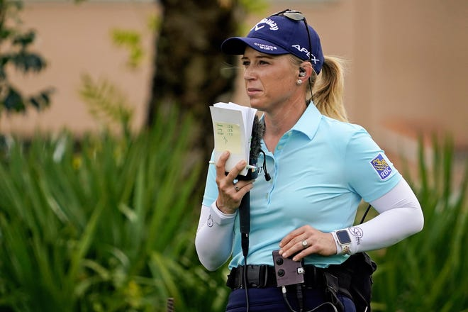 LPGA golfer and TV analyst Morgan Pressel works the second green during Friday's second round of the Honda Classic.