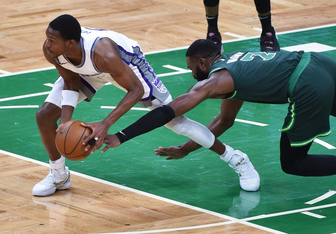 Kings guard De'Aaron Fox, left, steals the ball from Celtics forward Jaylen Brown during the second half of Friday night's game at TD Garden.