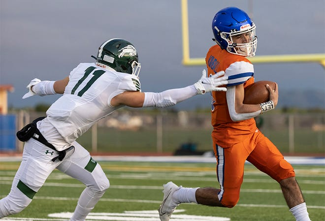 Kimball Jaguars quarterback Nicholas Coronada (6) runs the ball for a 10 yard gain during the second quarter in the game against Manteca High at Don Nicholson Stadium at Kimball High in Tracy on March 19.