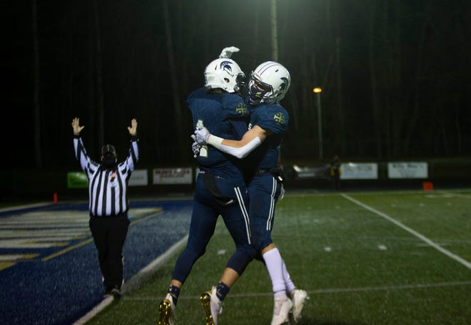 Marist's Dylan Martin, left, and Carter Greene celebrate a touchdown during the Spartans' 35-33 loss to Silverton earlier this season.