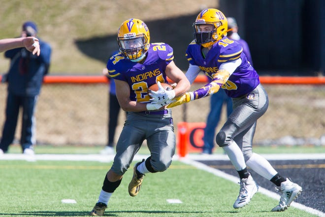 Hononegah returns 14 starters for the 2021 fall football season, including quarterback Isaac Whisenand and RB/WR/DB/K Bryce Goodwine, shown last year with Whisenand handing off to Goodwine against Belvidere North.