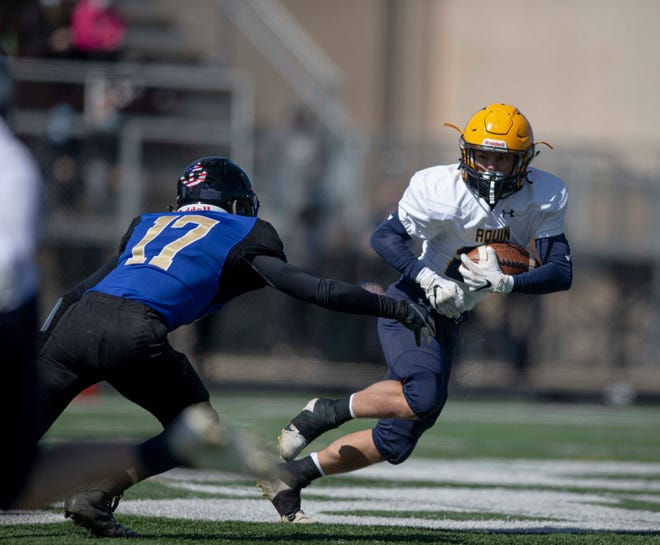 Aquin's Ty Stykel, shown running in the season opener against Durand/Pecatonica, leads the NUIC in rushing with 440 yards in three games for the 3-0 Bulldogs.