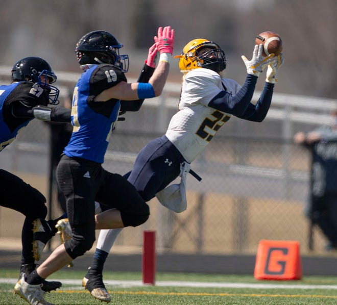 Aquin's Andrew Bowman attempts to catch the ball on Saturday, March 20, 2021, at Auburn High School.