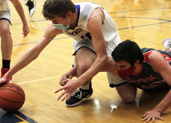 Dylan Palmer of Centreville and Juice Griffith of Constantine battle for a loose ball on Friday night.