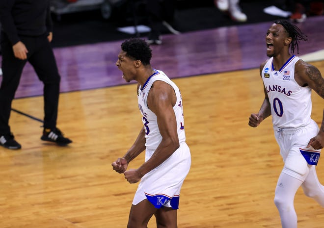 Kansas forward David McCormack, left, celebrates with guard Marcus Garrett during Saturday's game against Eastern Washington in Indianapolis. McCormack scored 22 points, including 20 in the second half, to power the three-seeded Jayhawks to a 93-84 victory.