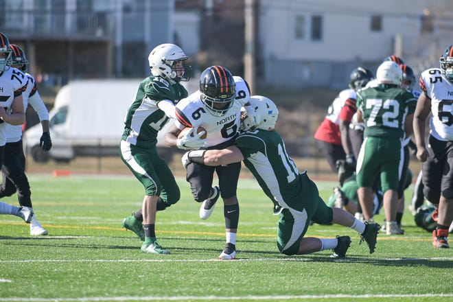 Bartlett's Sam Kontoes tackles North's Meshak Mbusa for a loss of yards during last week's game.