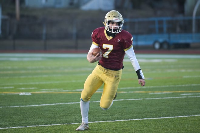 Doherty High senior quarterback Noah Callery sneaks out the pocket for a first down during last Friday's win over Algonquin.