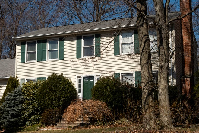 The death of a mother and daughter discovered inside this home on Ladyslipper Drive in Shrewsbury on Friday is being investigated by the office of Worcester District Attorney Joseph D. Early Jr.