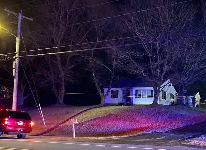 Crime scene tape surrounds a home on Palmer Road in Ware, where one person died in a fire Friday night.