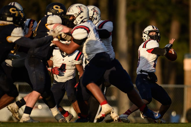 Bulldogs quarterback Dante Garcia looks to pass during the  Terry Sanford at Cape Fear football game on Friday, March 19, 2021.