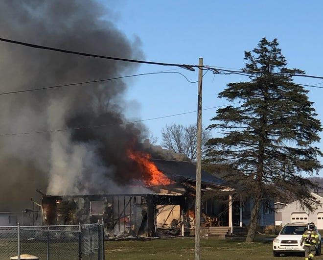 Barry Hostetler shot this photo of a house fire in Gnadenhutten on Saturday