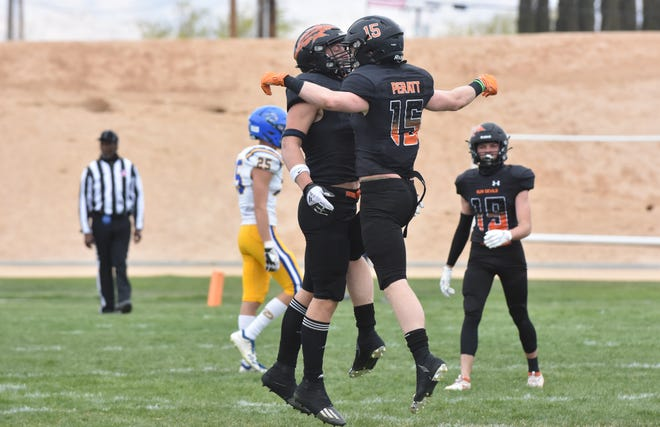 Apple Valley's Ethan Peratt, right, celebrates with a teammate during the fourth quarter against Serrano at Newton T. Bass on Saturday, March 20, 2021.
