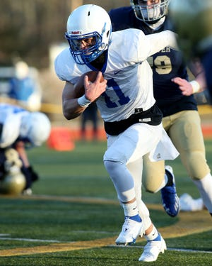 Scituate's Andrew Bossey turns upfield on a carry during first quarter action of their game against Hanover at Hanover High on Friday, March 19, 2021.