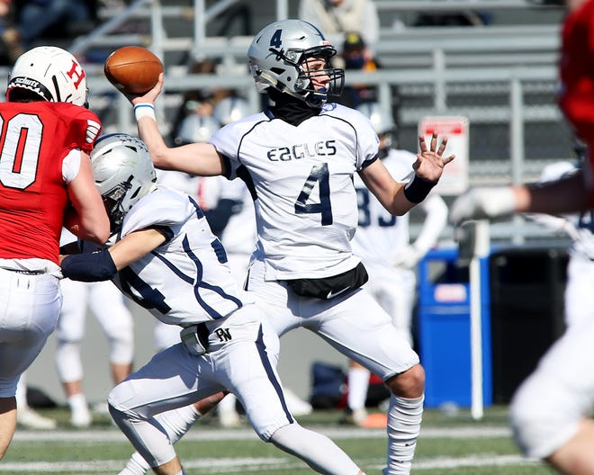 Plymouth North quarterback Dallas Murphy drops back for a pass.