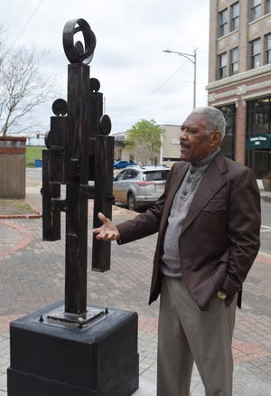 """""""Family,"""" a sculpture created by local and world renowned artist Morris Taft Thomas now gracesdowntown Alexandria on the corner of 3rd and Johnston Streets in downtown Alexandria."""
