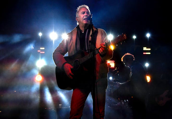 Actor Kevin Costner performs with his band Modern West at Friday's Outlaws & Legends music festival.