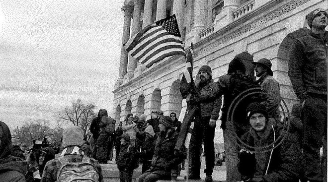 Ethan Seitz of Bucyrus is circled in this photo provided by the FBI showing him sitting on the steps of the U.S. Capitol during the riot of Jan. 6.