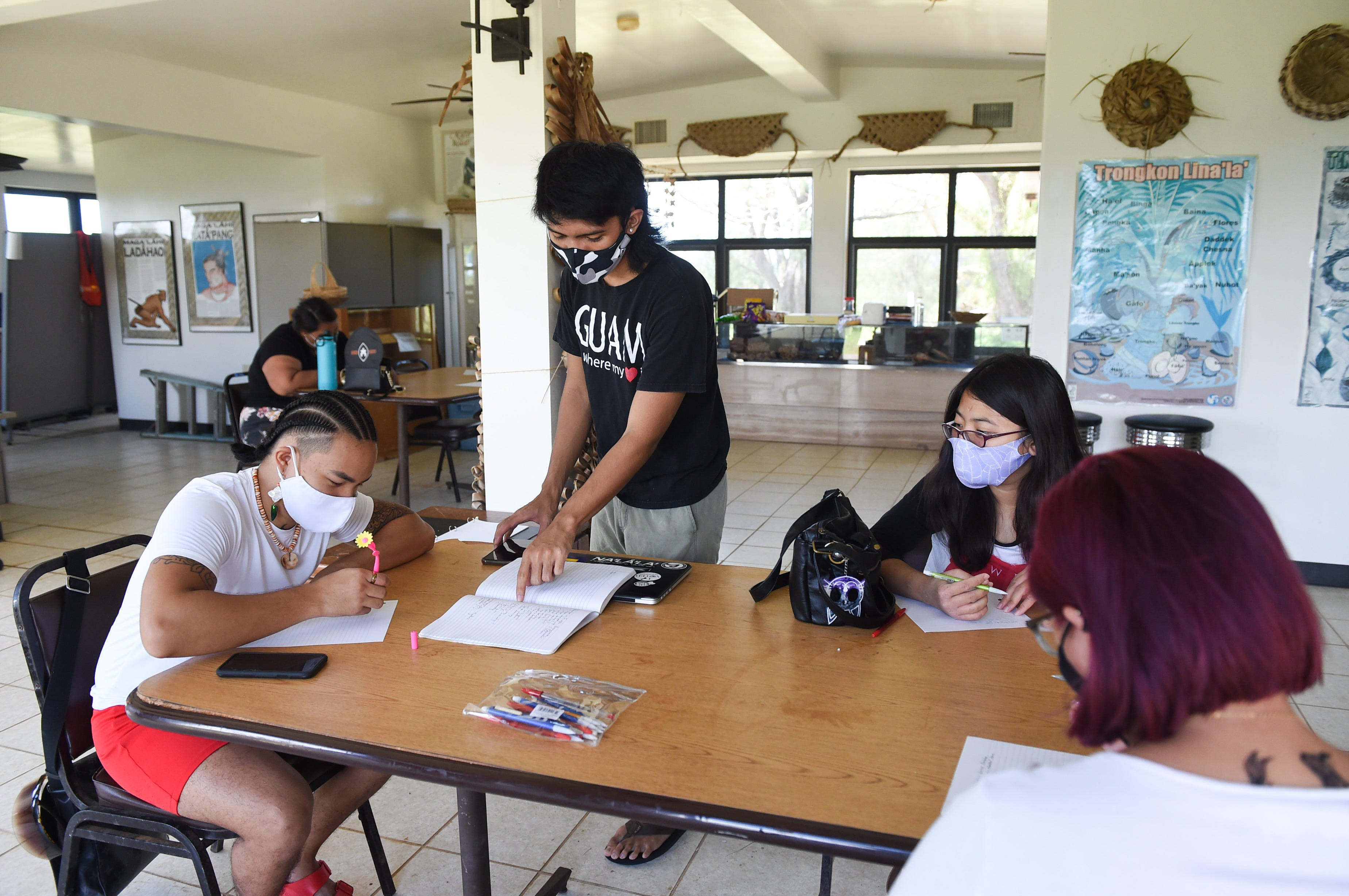 Instructor Eddie Acfalle explains an exercise to Caly Affleje during his writing workshop at Sagan Kotturan CHamoru Cultural Center in Tamuning, March 20, 2021.