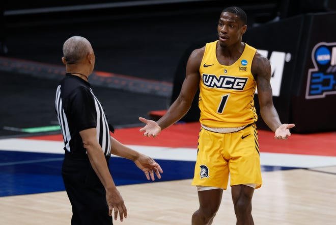 UNC Greensboro guard Isaiah Miller (1) reacts to a foul during their game against Florida State in the first round of the 2021 NCAA Tournament on Saturday, March 20, 2021, at Bankers Life Fieldhouse in Indianapolis, Ind.