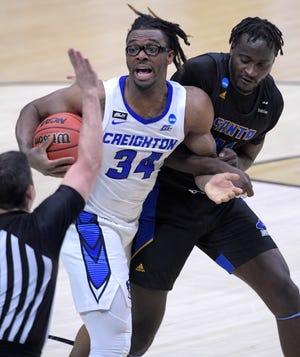 Creighton Bluejays guard Denzel Mahoney (34) reacts as to the official while being tied up with UC Santa Barbara Gauchos forward Robinson Idehen (24) during the first round of the 2021 NCAA Tournament on Saturday, March 20, 2021, at Lucas Oil Stadium in Indianapolis, Ind.
