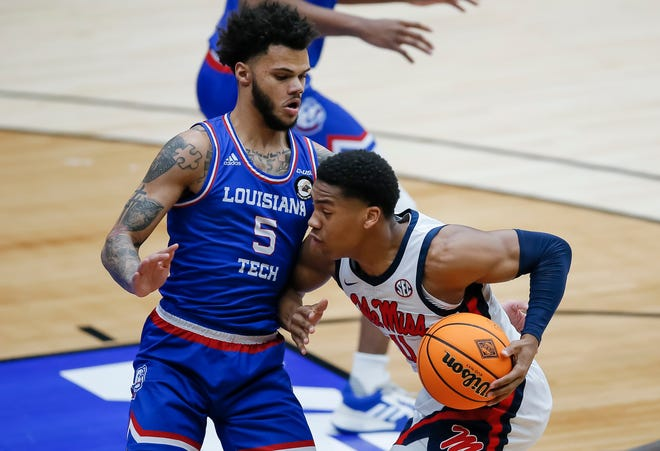 Mississippi guard Matthew Murrell (11) battles Louisiana Tech guard Kalob Ledoux (5) for space during the first half of an NCAA college basketball game in the NIT, Friday, March 19, 2021, in Frisco, Texas. (AP Photo/Brandon Wade)