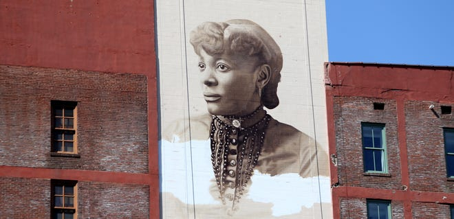 Henrietta Helm, one of the first Black students in Louisville's public schools and a former principal of the Portland Colored Evening School, had a mural made of her at 429 W. Muhammad Ali Blvd. The artists are Jared Diaz and Darius Dennis. 03/20/21