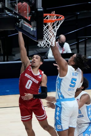 Badgers guard D'Mitrik Trice scores on a layup against Tar Heels forward Armando Bacot during the second half.
