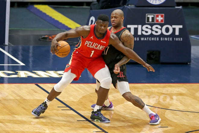 P.J. Tucker, shown with the Houston Rockets, looks to stop New Orleans Pelicans forward Zion Williamson during their game Jan. 30. Tucker, now with the Bucks, gives Milwaukee more options in its defensive lineups.