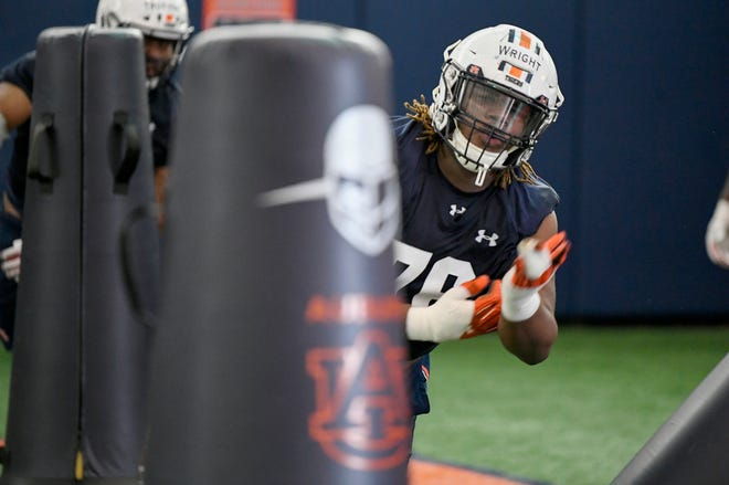 Auburn defensive lineman Jeremiah Wright (76) goes through a drill at practice on Thursday, March 18, 2021 in Auburn, Ala.