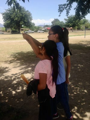 Elementary students measure wind speed in their schoolyard during an Asombro Institute for Science Education program in southern New Mexico.