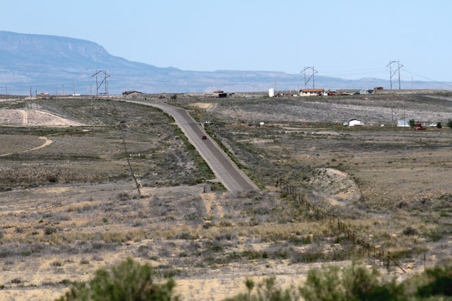 A stretch of Navajo Route 36 is pictured on April 21, 2017 near the San Juan Chapter house. Roads owned and maintained by the Navajo Nation have been closed to tourists over concern about the coronavirus.