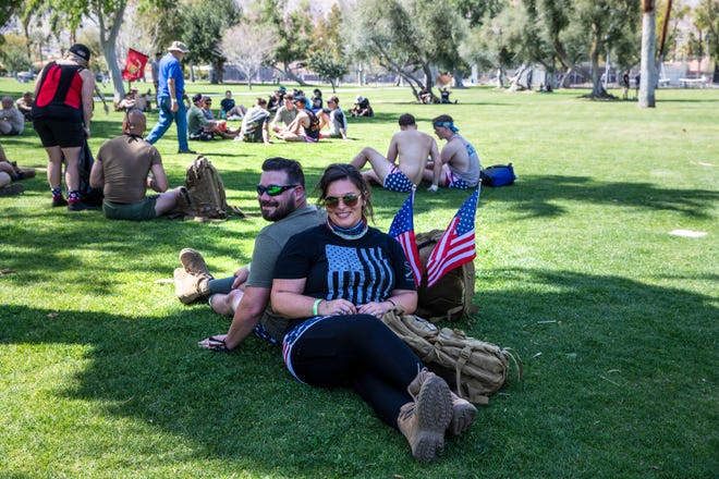 James and Heaton Dina of Mission Viejo rest at Ruth Hardy Park in Palm Springs, Calif., on March 20, 2021, during the Irreverent Warriors Silkies Hike.