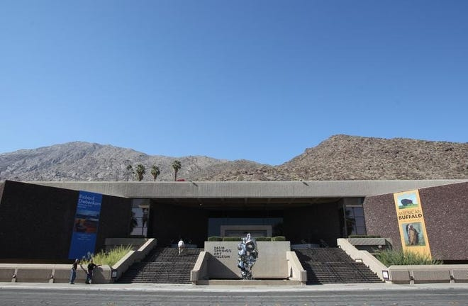 The 800-pound Zhan Wang sculpture shines in front of the Palm Springs Art Museum.