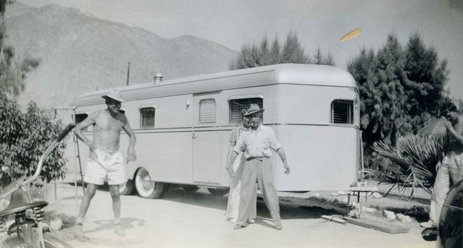 Men in front of a trailer. Identified on photo as Clyde, Joe, Freda and Fred.