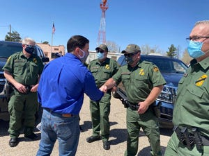 Gov. Doug Ducey (center left) meets with law enforcement and safety officials during a visit to the U.S.-Mexico border on March 19, 2021.