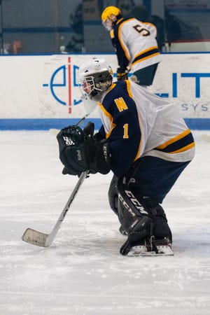 Port Huron Northern's Logan Sheffer warms up before their game against Marysville Friday, March 19, 2021, at Suburban Ice Macomb.