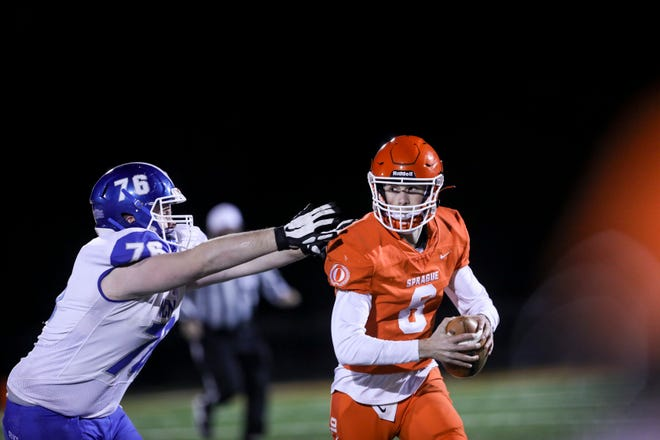 Sprague's Logan Smith (8) looks to make a pass during the game against McNary on Friday, March 19, 2021 at Sprague High School in Salem, Oregon.