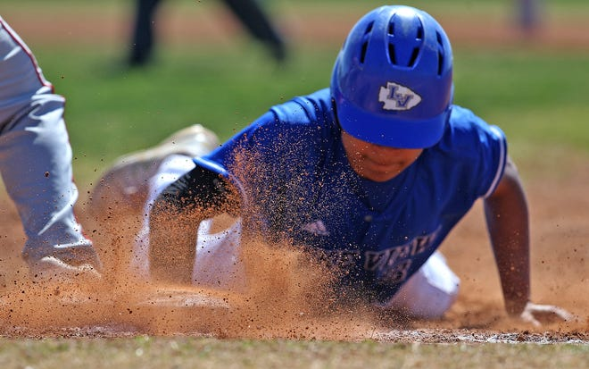 Lake View's Jacob Chappa dives back to first base during a game against Sweetwater on Saturday, March 20, 2021