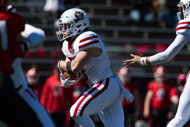 South Dakota's Travis Thesis looks for space during the second half at Youngstown State. He'd record a 1-yard touchdown run late in the contest during the Coyotes 28-10 loss to the Penguins.