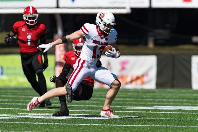 South Dakota senior Caleb Vander Esch tries to break away from YSU's Troy Jakubec Saturday afternoon at Youngstown State.