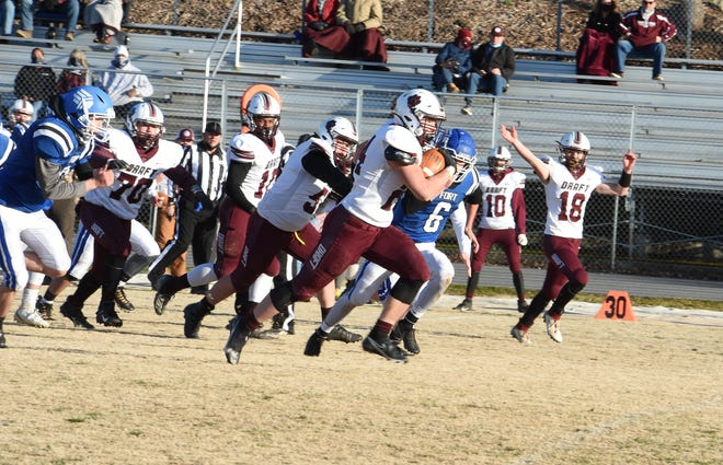 Stuarts Draft's Aaron Nice is off the races Friday night, March 19, on his way to a touchdown against Fort Defiance. Stuarts Draft won the game 35-0.