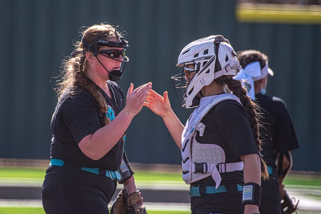 Pebble Hills player Peyton Ferris, left, and catcher Yazzy Avila celebrate after a strikeout.  Eastwood defeated Pebble Hills High School, 7-6, in the 8th inning in District 1-6A softball at Hanks High School on March 20, 2021.